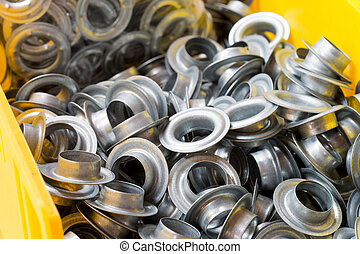 Metal eyelets in a crate