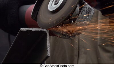 Metal Fabrication - Angle grinder cut metal. Sparks slowly...
