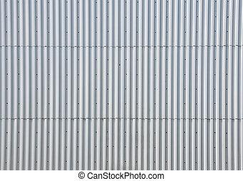 Metal facade of a building - A silver metal facade of a...