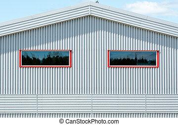 Metal fasade - Grey metal fasade and red window frames.