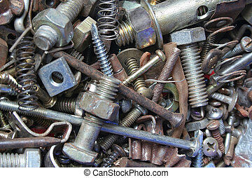 An assortment of rusty metal fasteners