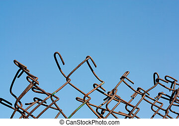 metal fence against the blue sky