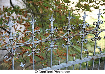 Metal curly fence in the park