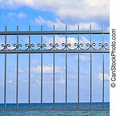 Metal fence on seashore