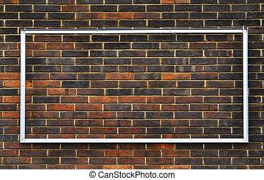 Metal frame on a brick wall