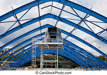 Metal frame structure on constraction site of the shopping mall building