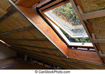 Metal frames on attic skylight window and environmentally friendly and energy efficient thermal insulation rock wool