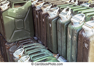 metal fuel tank or jerry can for transporting and storing gasoline or diesel fuel store, can use motor oil or fuel concept background