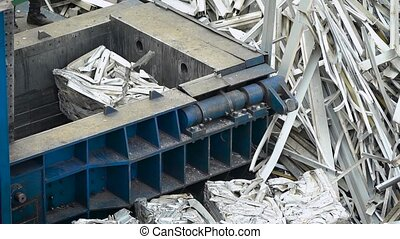 the process of garbage processing, the machine presses the metal into square blocks, in order to put the garbage into recycling and use it in industrial production