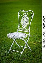 metal garden chair on grass