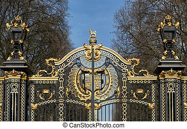 Metal gate decorated with golden ornaments