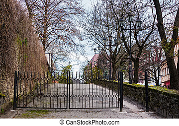 metal gates on the street of old town. lovely scenery with...