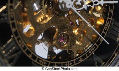 Metal gears in perpetual motion. Close up - Metal gears in...