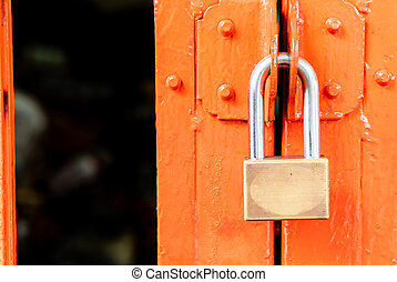 metal golden padlock on door