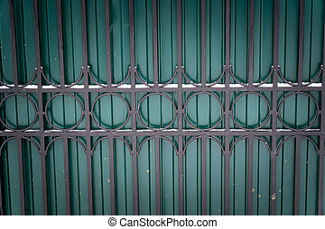 metal green fence background. forged fence.
