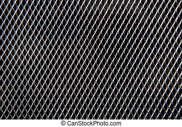 Metal grid on black background