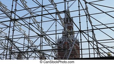 RUSSIA, MOSCOW - September 08, 2018: Against the backdrop of the Clock on the Spassky Tower and the Cathedral of Basil the Blessed, the metal grille of the stage design. During the celebration of the capital of Russia, Moscow birthday 871 years. Dancers, singers, animators and master classes. In ...