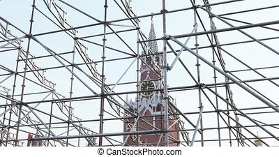 RUSSIA, MOSCOW - September 08: Against the backdrop of the Clock on the Spassky Tower and the Cathedral of Basil the Blessed, the metal grille of the stage design. During the celebration of the capital of Russia, Moscow birthday 871 years. Dancers, singers, animators and master classes. In September...