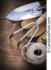 Metal hand spade rake pair of brown leather gardening gloves and