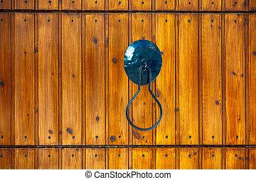 Metal handle on wooden door.