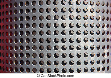metal holed or perforated grid background
