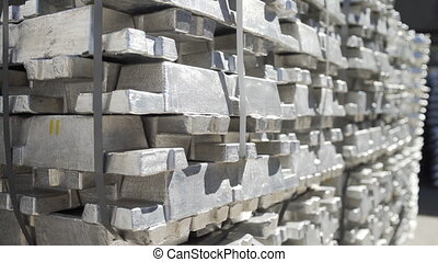 Metal ingots in Aluminium foundry. Billets for aluminium profile production at a metallurgical plant