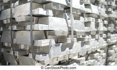 Metal ingots in Stock Warehouse. Billets for aluminium profile production at a metallurgical plant