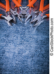 Metal insulated electric cutting pliers gripping tongs copy space image.