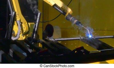 Metal iron laser argon welding on industrial CNC machine in...