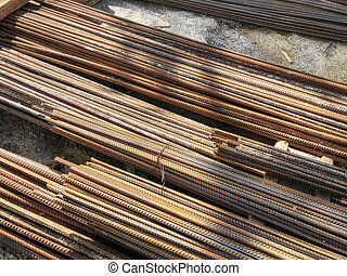 Metal, iron reinforcement lying on the ground on the construction site. Material for repairs in an apartment is under construction remodeling rebuilding and renovation.
