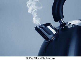 metal kettle closeup in kitchen