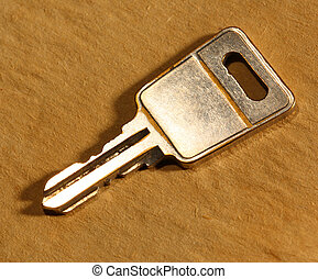 Metal key on paper background