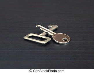 Metal Keys - Metal keys on a wooden surface.