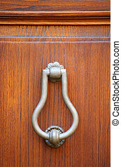 metal knocker on wooden door