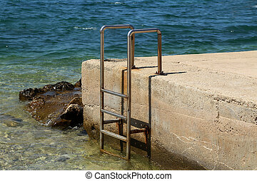 Metal ladder for launching into the water