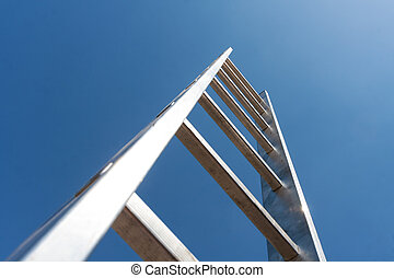 High metal ladder leading to the sky