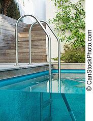 Metal ladder in a swimming pool