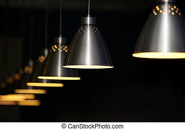 Metal lamps - Many metal lamps at dark restaurant