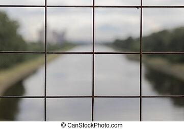Metal lattice overlooking the river.