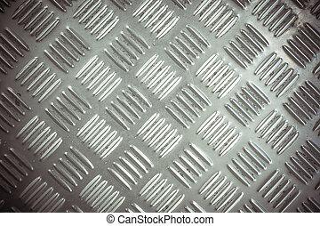 Metal list with rhombus shapes. Macro texture