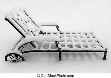 Metal Lounge Chair in the Snow