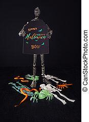 Metal mannequin holding Halloween sign
