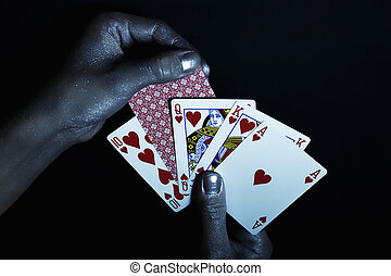 Metal men's hands with playing cards