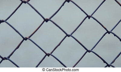Metal mesh. Fencing.Full hd video - Metal fence of rods....