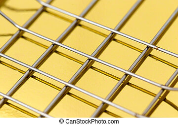 metal mesh on a gold background