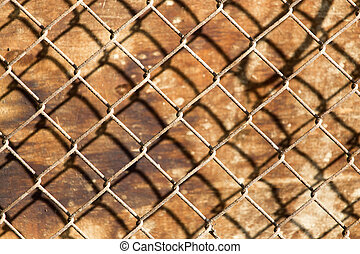 metal mesh on the wood background