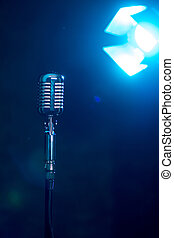 Metal microphone on a blue background.