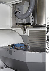 metal milling machine - industrial workplace with millcut...