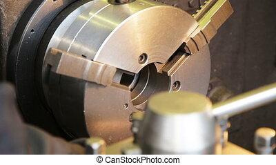 metal milling machine - operator adjusts the milling...