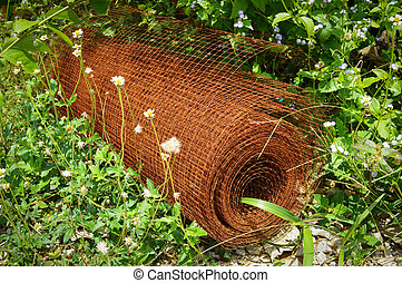 metal net steel in rolls of iron mesh (wire mesh) with rust use for reinforce concrete in construction site